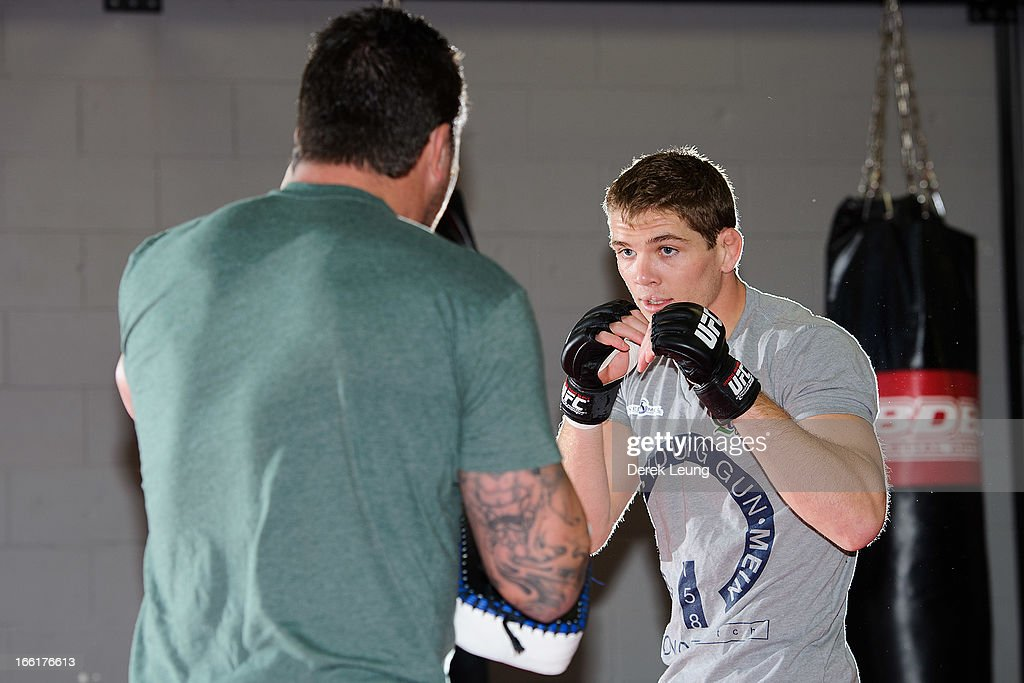 Jordan Mein works on his strikes with his father Lee Mein during a public training session on April 9, 2013 at Champion's Creed Gym in Calgary, Alberta, Canada.