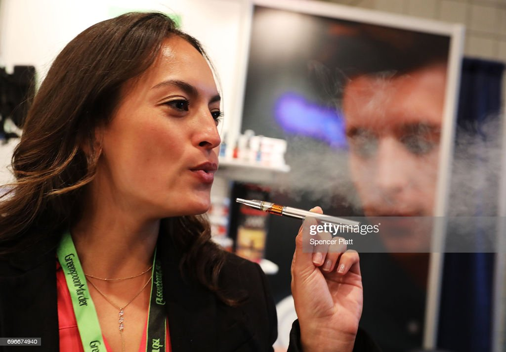 Jordan Michelle vapes a CBD oil made from hemp at the Cannabis World Congress Conference on June 16, 2017 in New York City. Billed as 'the leading trade show and conference for the legalized cannabis, medical marijuana, and industrial hemp industries,' the 4th annual conference brings together dozens of both small and large businesses involved in the growing hemp and marijuana market.