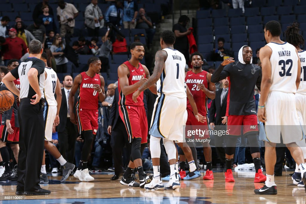 Jordan Mickey #25 of the Miami Heat and Jarell Martin #1 of the Memphis Grizzlies after the game on December 11, 2017 at FedExForum in Memphis, Tennessee.