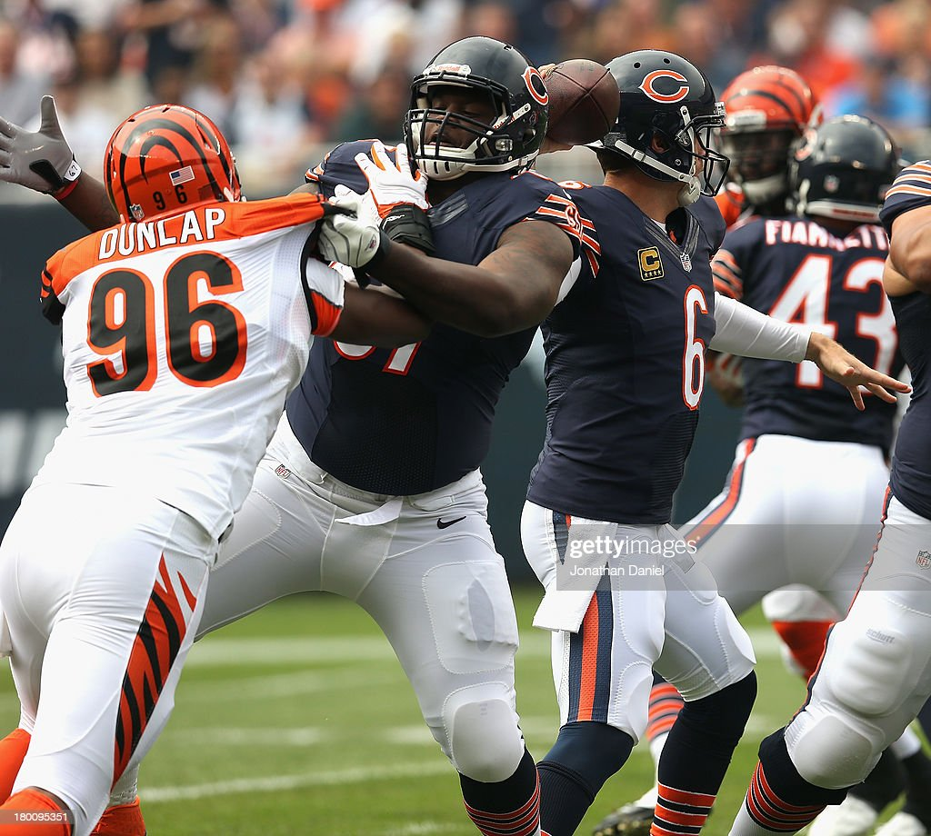 Jordan Mills #67 of the Chicago Bears blocks Carolos Dunlap #96 of the Cincinnati Bengals at Soldier Field on September 8, 2013 in Chicago, Illinois. The Bears defeated the Bengals 24-21.