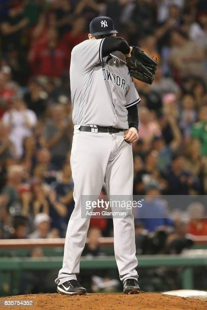 Jordan Montgomery of the New York Yankees reacts after giving up a home run to Christian Vazquez of the Boston Red Sox in the fifth inning of a game...