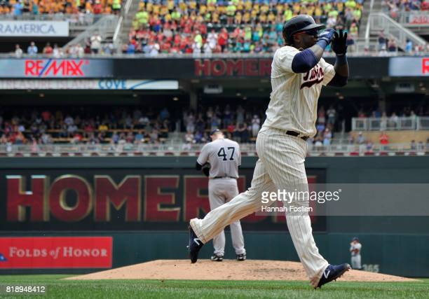 Jordan Montgomery of the New York Yankees reacts as Miguel Sano of the Minnesota Twins celebrates a threerun home run as he rounds the bases during...