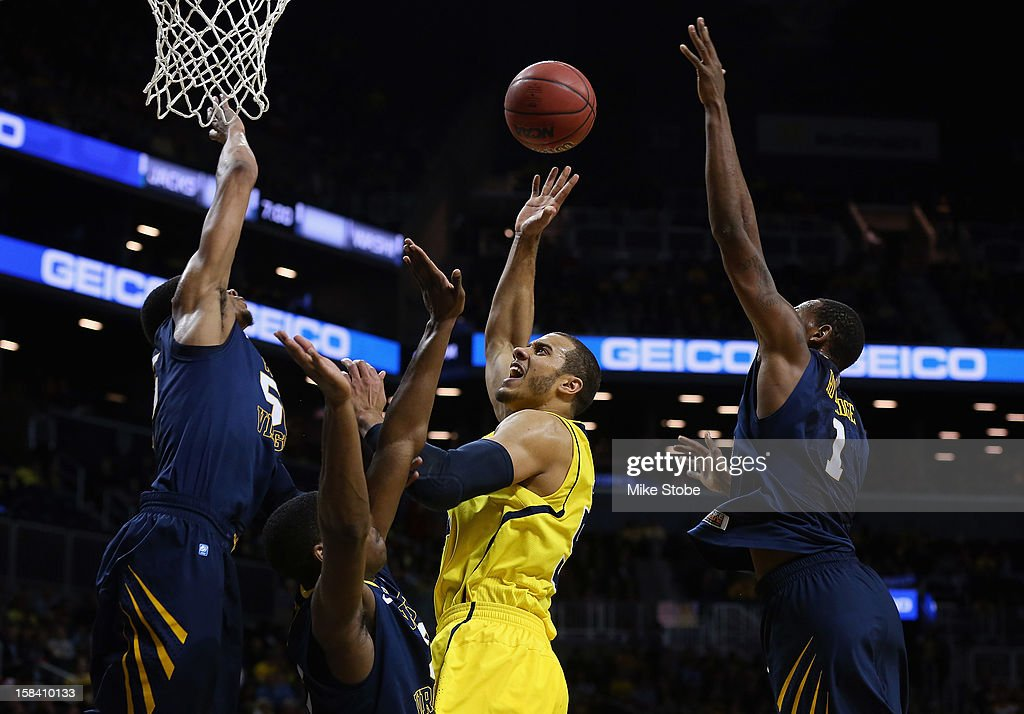 Jordan Morgan #52 of the Michigan Wolverines drives to the net against West Virginia Mountaineers during the Brooklyn Hoops Winter Festival on December 15, 2012 at Barclays Center in the Brooklyn borough of New York City. Michigan Wolverines defeated West Virginia Mountaineers 81-66.