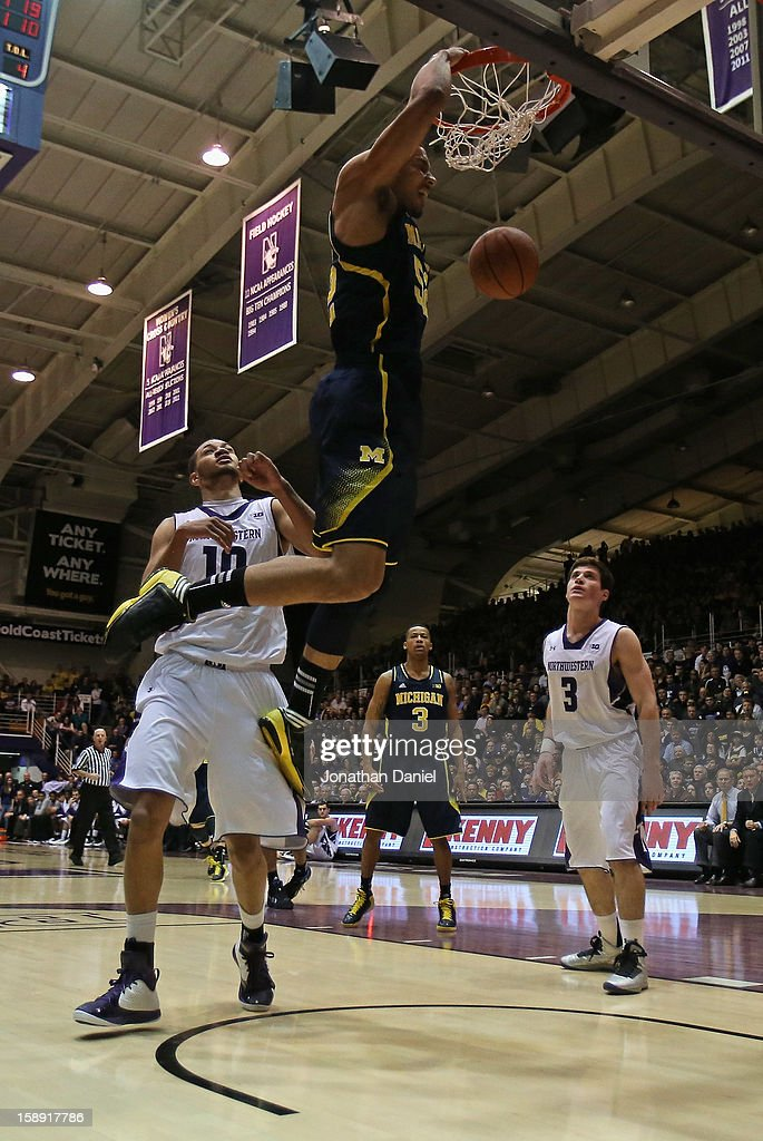 Jordan Morgan #52 of the Michigan Wolverines dunks over Mike Turner #10 and Dave Sobolewski #3 of the Northwestern Wildcats at Welsh-Ryan Arena on January 3, 2013 in Evanston, Illinois. Michigan defeated Northwestern 94-66.
