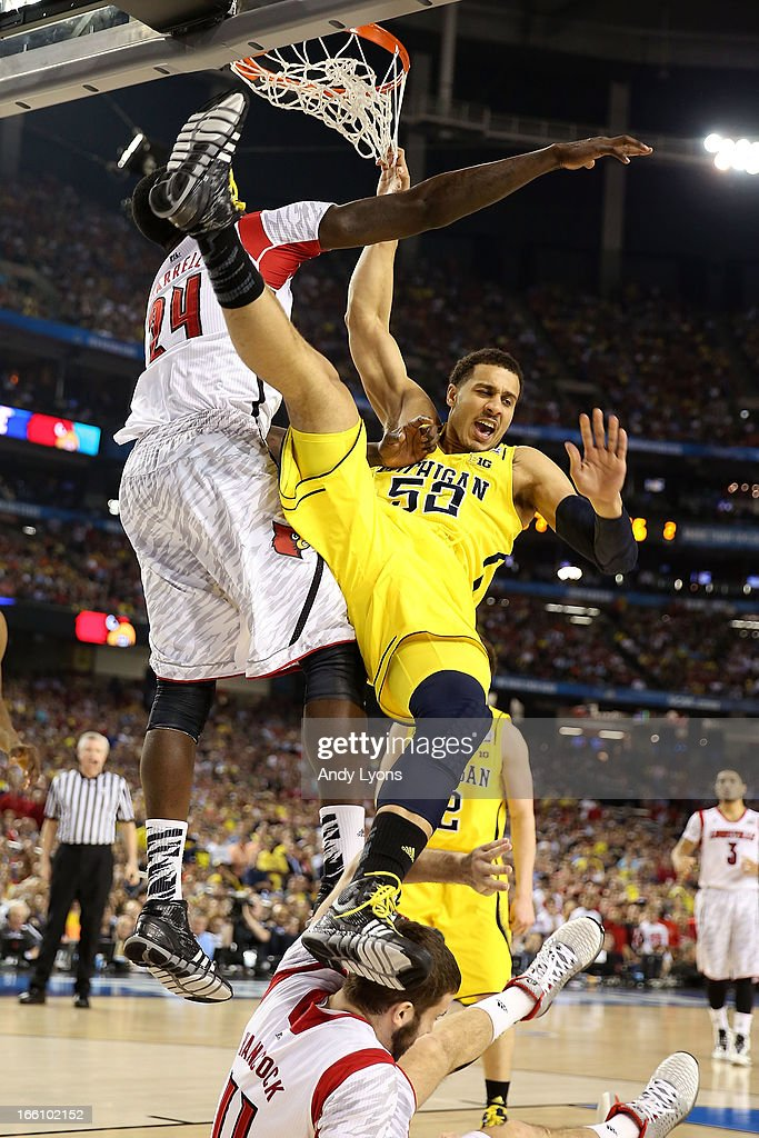 Jordan Morgan #52 of the Michigan Wolverines falls to the court after he attempted a shot against Montrezl Harrell #24 and <a gi-track='captionPersonalityLinkClicked' href=/galleries/search?phrase=Luke+Hancock&family=editorial&specificpeople=6560051 ng-click='$event.stopPropagation()'>Luke Hancock</a> #11 of the Louisville Cardinals during the 2013 NCAA Men's Final Four Championship at the Georgia Dome on April 8, 2013 in Atlanta, Georgia.
