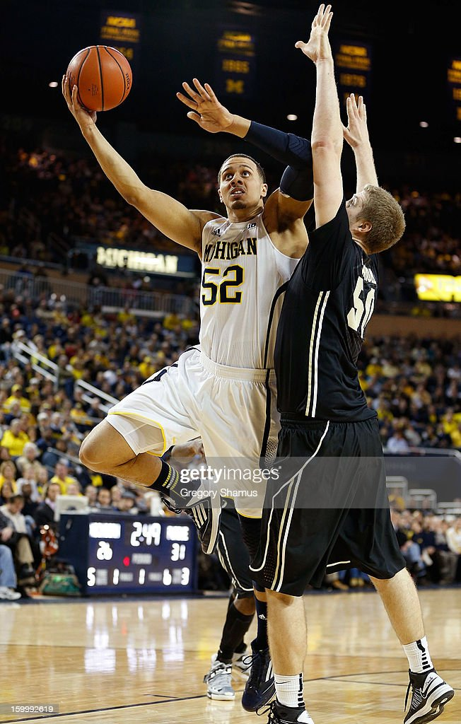 Jordan Morgan #52 of the Michigan Wolverines gets a first half shot off against Travis Carroll #50 of the Purdue Boilermakers at Crisler Center on January 24, 2013 in Ann Arbor, Michigan.