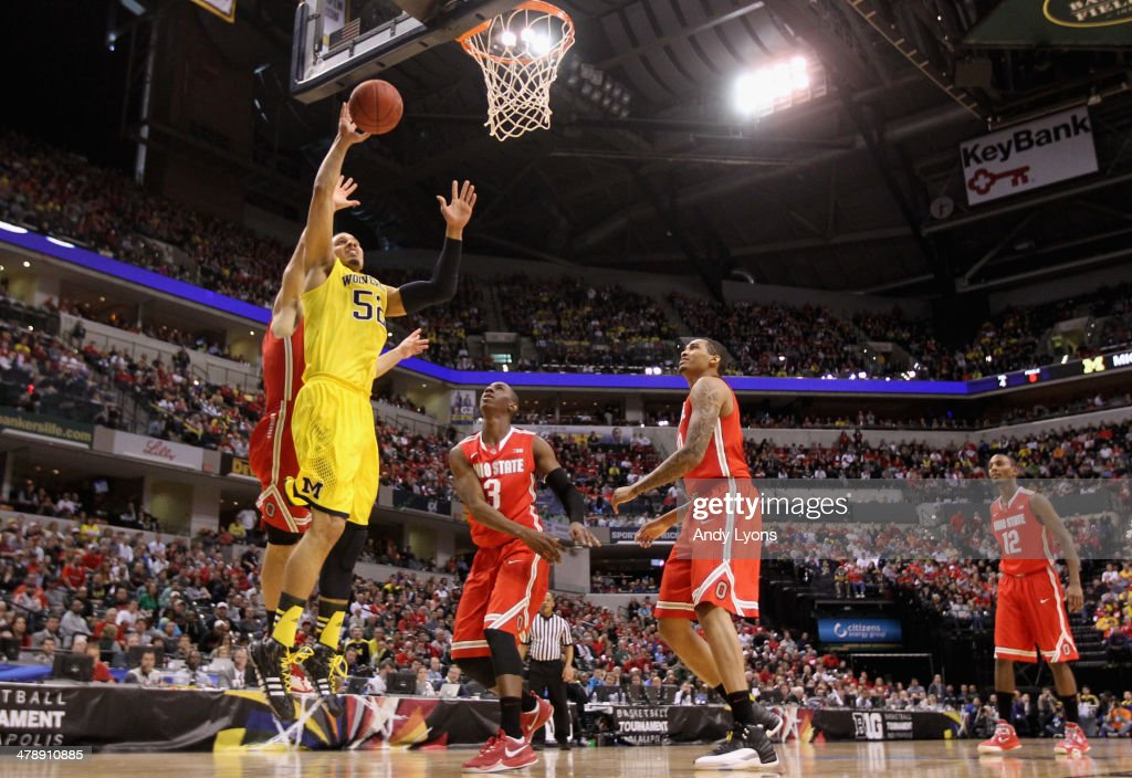 Jordan Morgan #52 of the Michigan Wolverines goes up for a shot during the first half of the Big Ten Basketball Tournament Semifinal game against the Ohio State Buckeyes at Bankers Life Fieldhouse on March 15, 2014 in Indianapolis, Indiana.