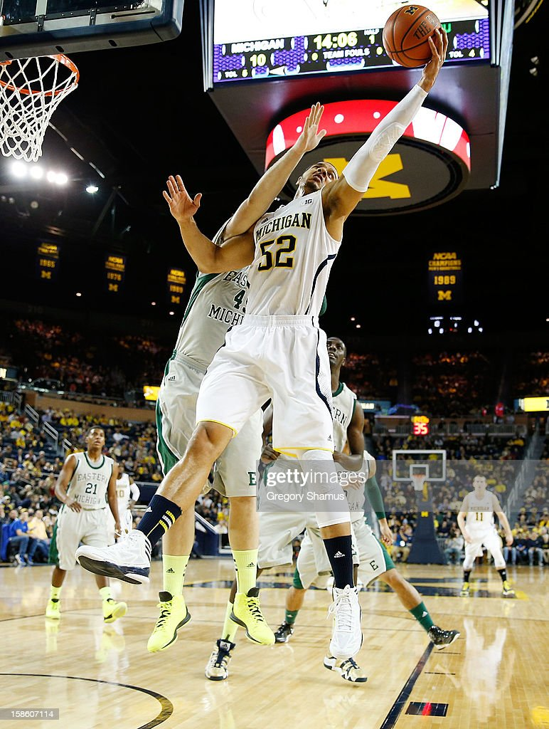 Jordan Morgan #52 of the Michigan Wolverines grabs a first half rebound in front of Matt Balkema #45 of the Eastern Michigan Eagles at Crisler Center on December 20, 2012 in Ann Arbor, Michigan.