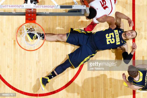 Jordan Morgan of the Michigan Wolverines reacts after being called for a foul during the game against the Indiana Hoosiers at Assembly Hall on...
