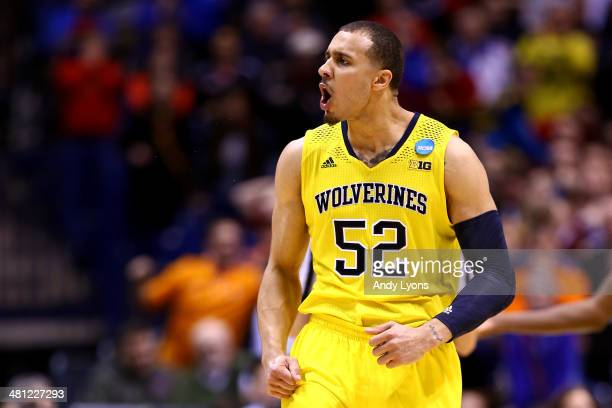 Jordan Morgan of the Michigan Wolverines reacts against Tennessee Volunteers during the regional semifinal of the 2014 NCAA Men's Basketball...