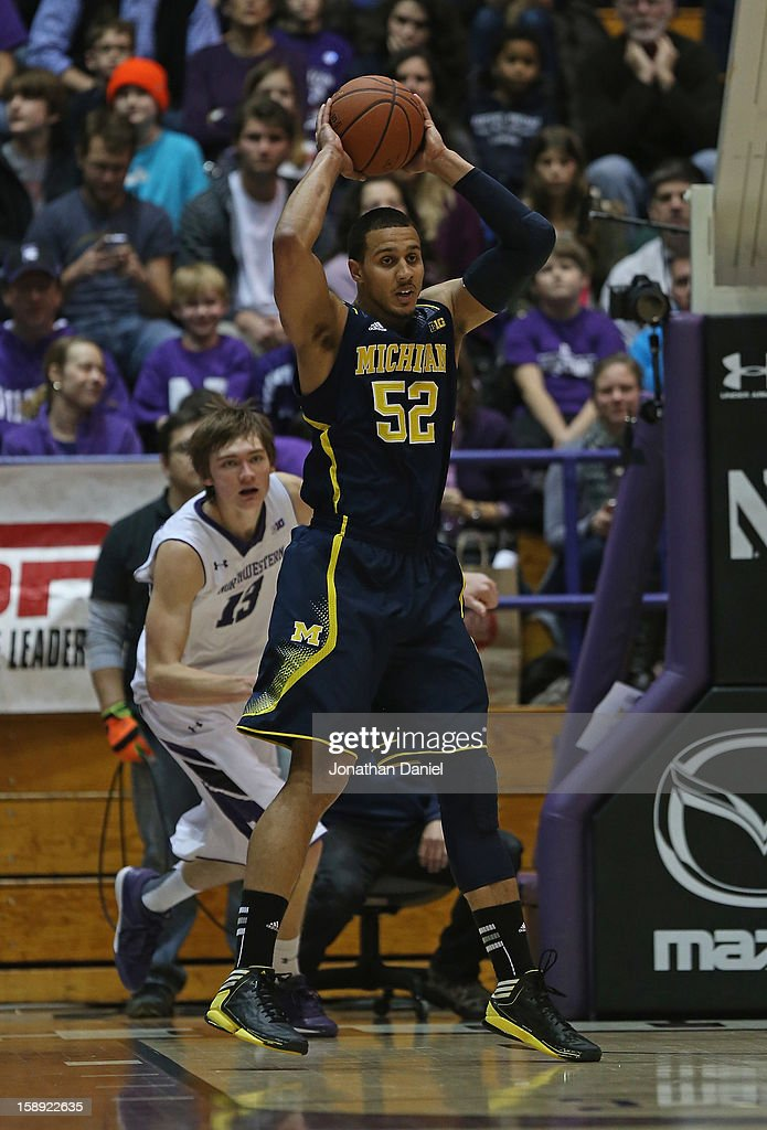 Jordan Morgan #52 of the Michigan Wolverines rebounds against the Northwestern Wildcats at Welsh-Ryan Arena on January 3, 2013 in Evanston, Illinois. Michigan defeated Northwestern 94-66.