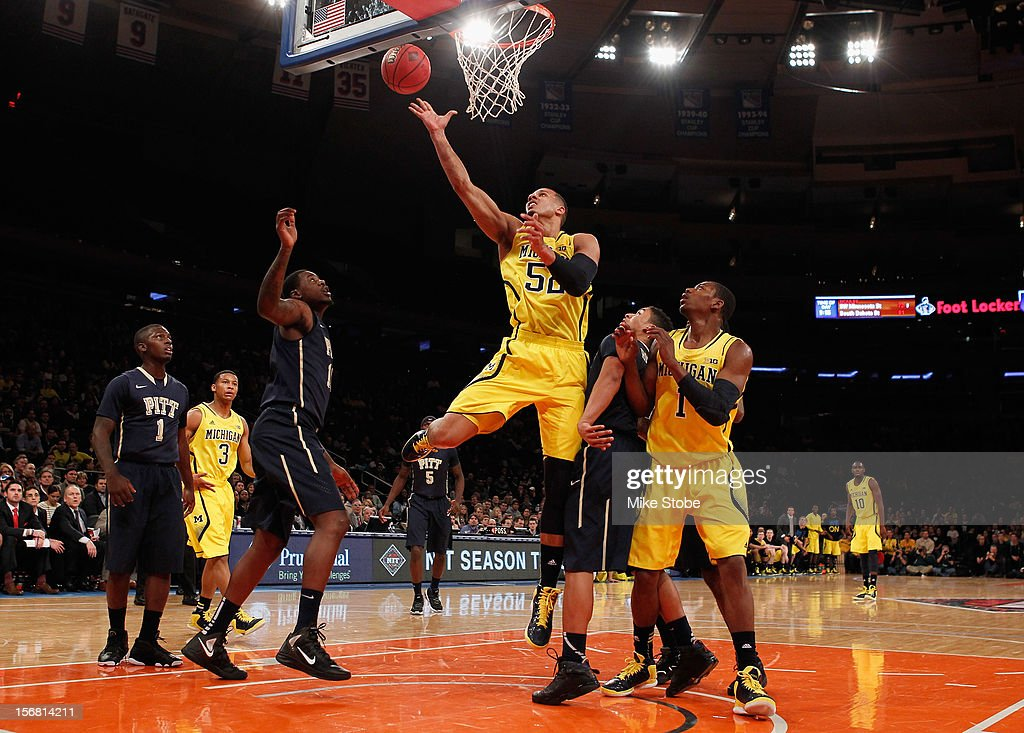 Jordan Morgan #52 of the Michigan Wolverines shots the ball against the Pittsburgh Panthers during the NIT Season Tip-Off at Madison Square Garden on November 21, 2012 in New York City. Michigan defeated Pittsburgh 67-62.