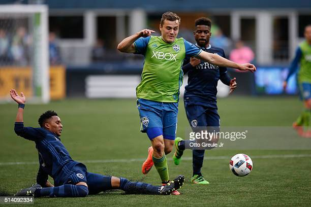 Jordan Morris of the Seattle Sounders FC dribbles against Amadou Dia of Sporting Kansas City at CenturyLink Field on March 6 2016 in Seattle...