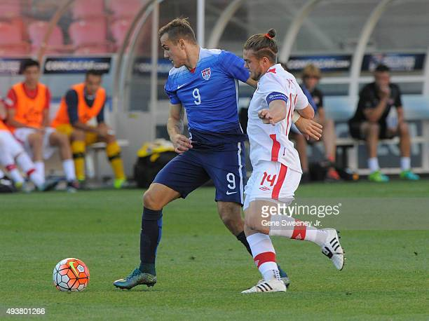 Jordan Morris of the United States fights for the ball with Sam Piette of Canada during the third place CONCACAF Olympic Qualifying match at Rio...