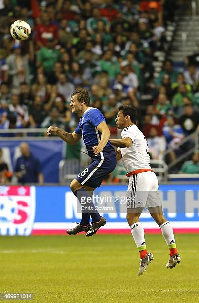 Jordan Morris of the United States jumps for a header over Oswaldo Alanis of Mexico during an international friendly match at the Alamodome on April...