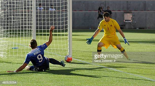 Jordan Morris of United States tries unsuccessfully for a goal while goal keeper Maxime Crepeau of Canada looks on during the first half of the third...