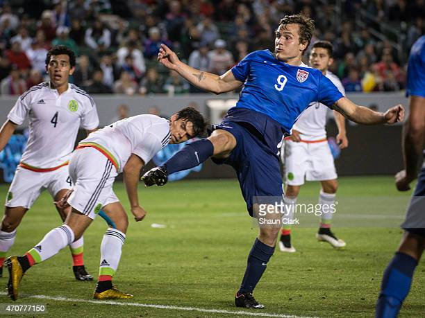 Jordan Morris of USMNT U23 scores a goal as Luis Guzman and Pedro Hernandez of the Mexico U23 team look on during the International Soccer Friendly...