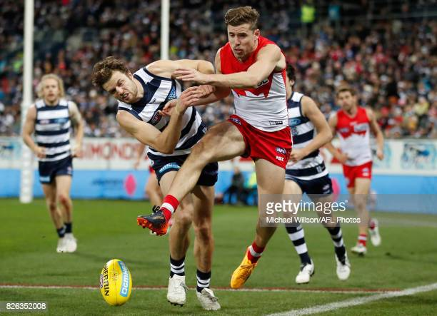Jordan Murdoch of the Cats and Jake Lloyd of the Swans in action during the 2017 AFL round 20 match between the Geelong Cats and the Sydney Swans at...