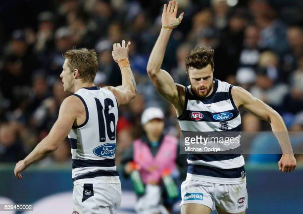 Jordan Murdoch of the Cats celebrates a goal with Scott Selwood of the Cats during the round 23 AFL match between the Geelong Cats and the Greater...