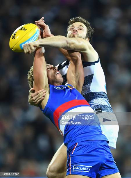 Jordan Murdoch of the Cats spoils a mark by Mitch Wallis of the Bulldogs during the round nine AFL match between the Geelong Cats and the Western...