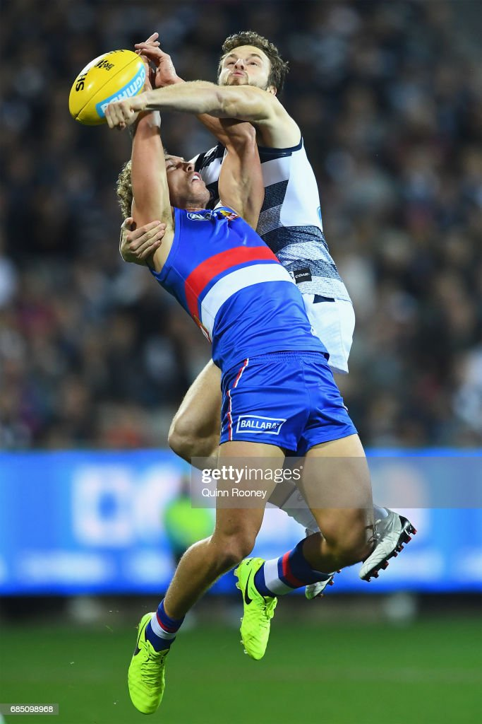 Jordan Murdoch of the Cats spoils a mark by Mitch Wallis of the Bulldogs during the round nine AFL match between the Geelong Cats and the Western Bulldogs at Simonds Stadium on May 19, 2017 in Geelong, Australia.