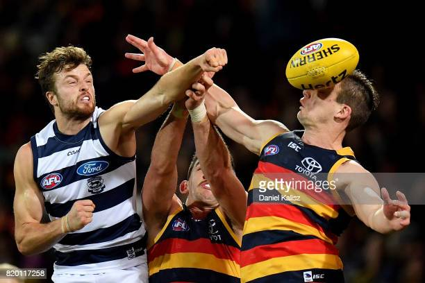 Jordan Murdoch of the Cats Taylor Walker of the Crows and Josh Jenkins of the Crows copete for the mark during the round 18 AFL match between the...