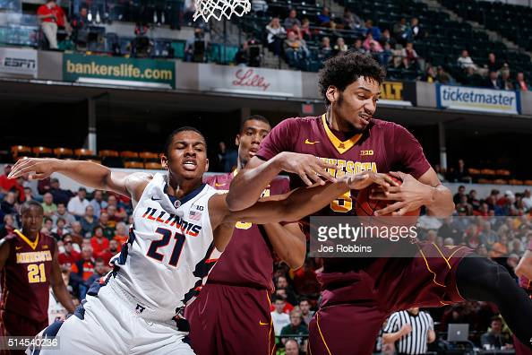 Jordan Murphy of the Minnesota Golden Gophers pulls a rebound away from Malcolm Hill of the Illinois Fighting Illini in the first round of the Big...