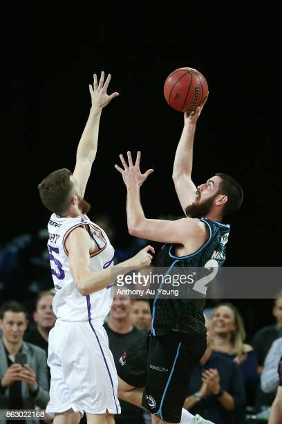 Jordan Ngatai of the Breakers puts up a shot against Adam Thoseby of the Kings during the round three NBL match between the New Zealand Breakers and...
