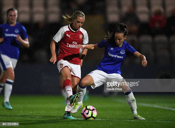 Jordan Nobbs of Arsenal is challenged by Marthe Munsterman of Everton during the match between Arsenal Women and Everton Ladies at Meadow Park on...