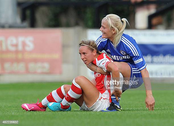 Jordan Nobbs of Arsenal is grabbed by Katie Chapman of Chelsea during the WSL match between Chelsea Ladies and Arsenal Ladies on July 16 2014 in...