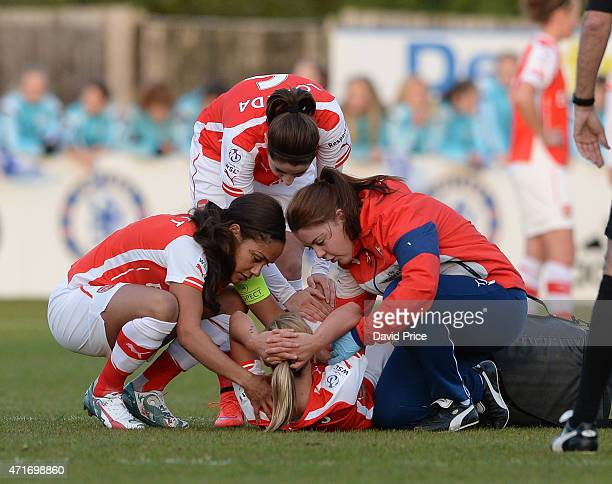Jordan Nobbs of Arsenal Ladies comforted by Alex Scott and Vicky Losada and Arsenal Physio Mary Shiels after getting injured during the match between...