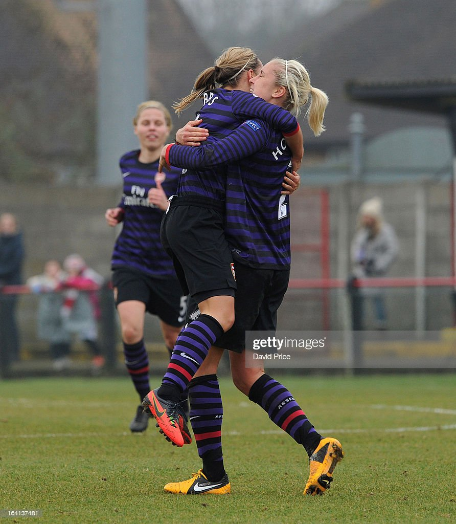 Jordan Nobbs (L) of Arsenal Ladies FC celebrates with team-mate Steph Houghton after scoring their 2nd goal with during the Women's Champions League Quarter Final match between Arsenal Ladies FC and ASD Torres CF at Meadow Park on March 20, 2013 in Borehamwood, United Kingdom.
