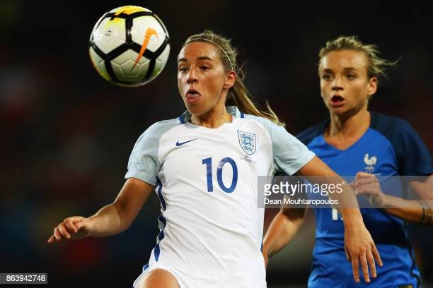Jordan Nobbs of England battles for the ball with Marion Torrent of France during the International friendly match between France and England held at...