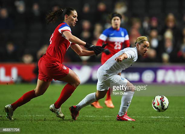 Jordan Nobbs of England evades Lauren Holiday of the United States during the Women's Friendly International match between England and USA at Stadium...