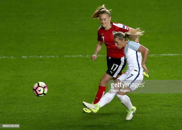 Jordan Nobbs of England misses a chance as Sarah Puntigam of Austria moves in during the Women's International Friendly match between England and...