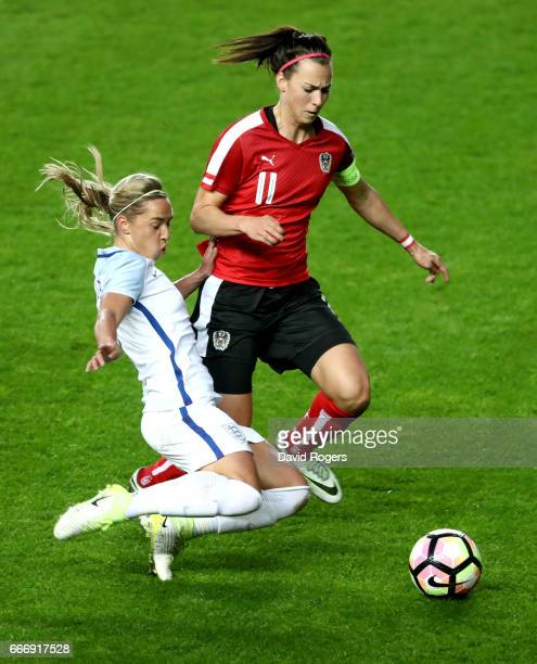 Jordan Nobbs of England tackles Viktoria Schnaderbeck of Austria during the Women's International Friendly match between England and Austria at...