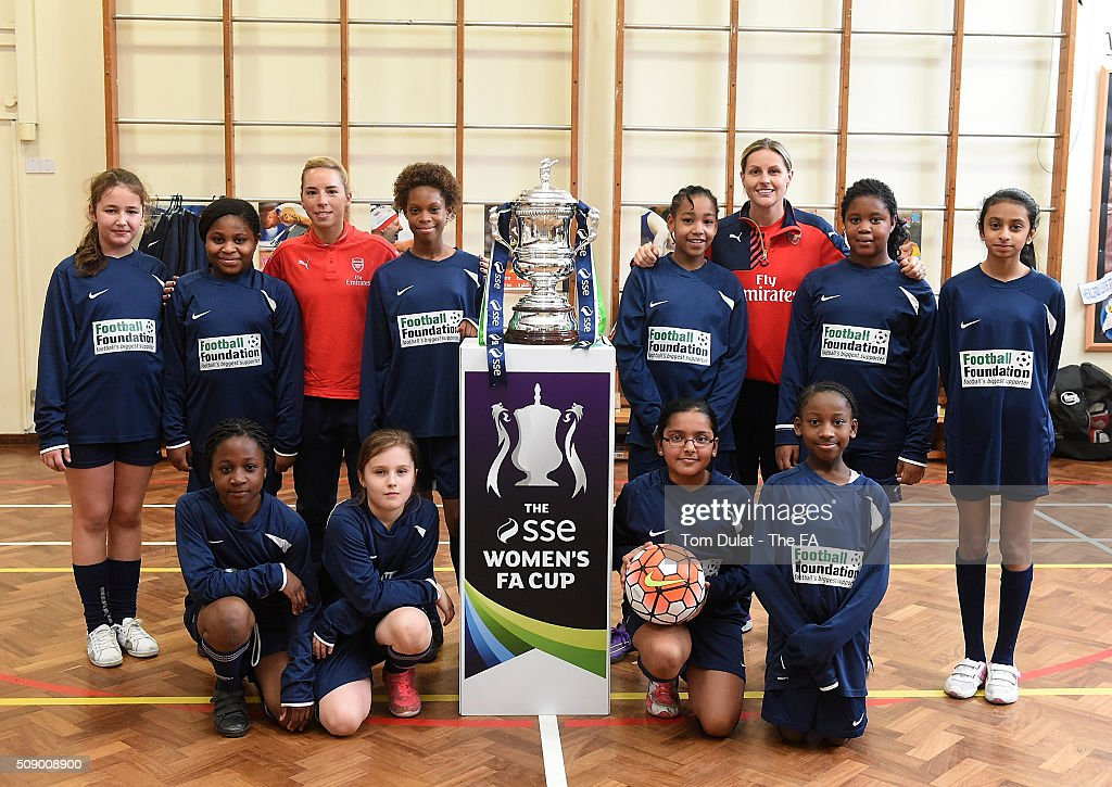 <a gi-track='captionPersonalityLinkClicked' href=/galleries/search?phrase=Jordan+Nobbs&family=editorial&specificpeople=5584926 ng-click='$event.stopPropagation()'>Jordan Nobbs</a> (L) together with Kelly Smith (R) of Arsenal Ladies and the kids pose for photographs with The SSE Women's FA Cup Trophy during the SSE Women's FA Cup Draw on February 8, 2016 in London, England. (Photo by Tom Dulat - The FA/The FA via Getty Images).