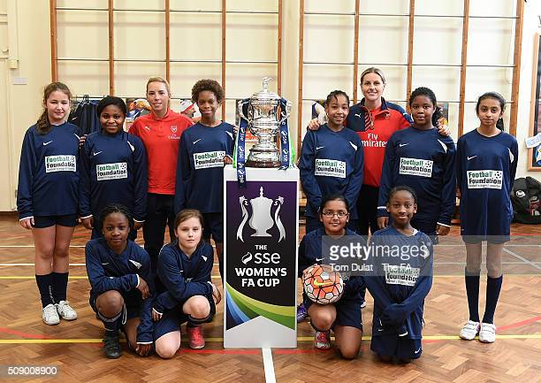 Jordan Nobbs together with Kelly Smith of Arsenal Ladies and the kids pose for photographs with The SSE Women's FA Cup Trophy during the SSE Women's...