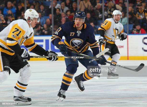 Jordan Nolan of the Buffalo Sabres skates against Evgeni Malkin of the Pittsburgh Penguins during an NHL game on December 1 2017 at KeyBank Center in...