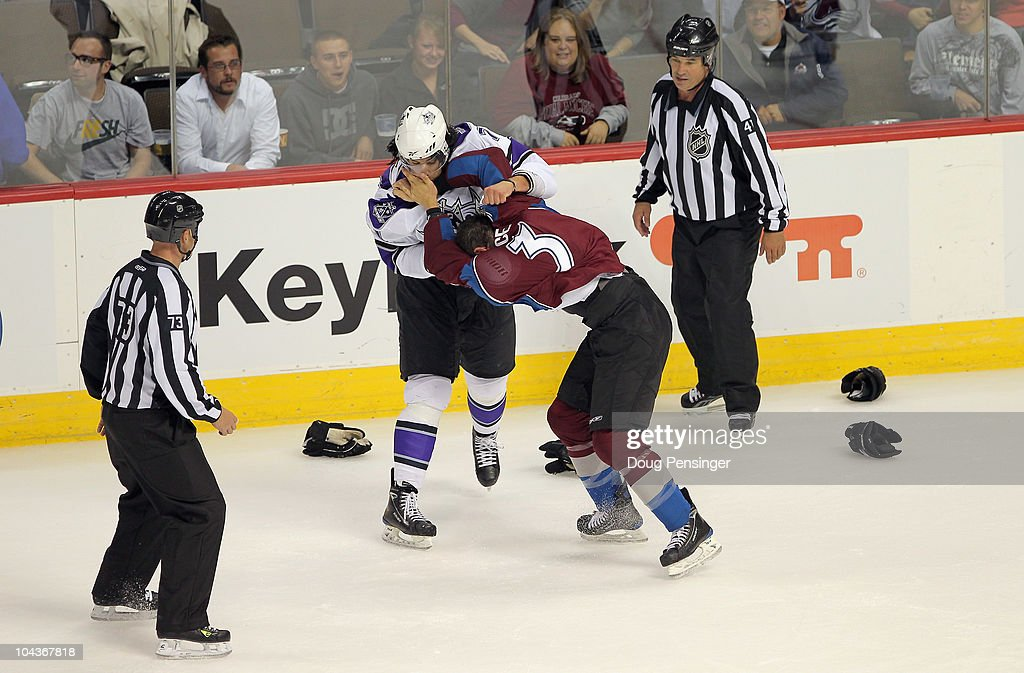 Jordan Nolan #71 of the Los Angeles Kings and Cameron Gaunce #3 of the Colorado Avalanche engage in a fight as linesmen Vaughn Rody (L) and Dan Schachte (R) prepare to intervene during preseason NHL action at the Pepsi Center on September 22, 2010 in Denver, Colorado.