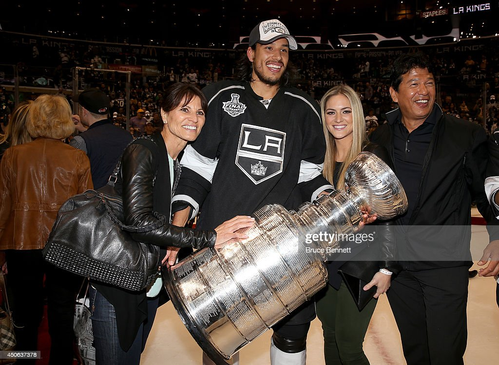 Jordan Nolan of the Los Angeles Kings celebrates with the Stanley Cup and his family including his dad Ted Nolan after the Kings win the Stanley Cup...