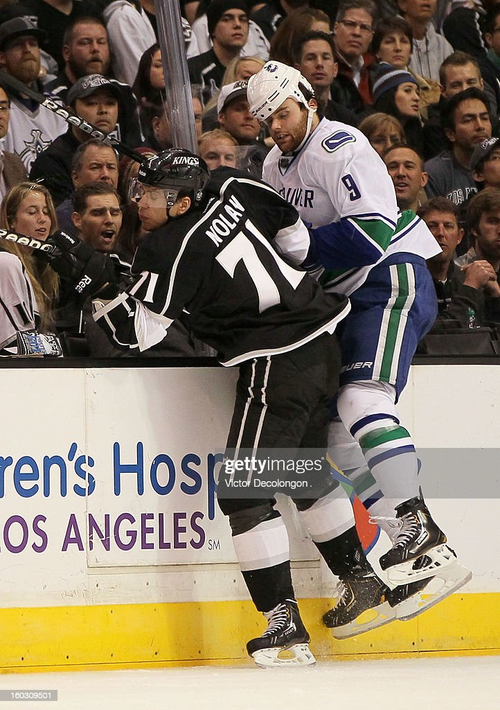 <a gi-track='captionPersonalityLinkClicked' href=/galleries/search?phrase=Jordan+Nolan&family=editorial&specificpeople=4161890 ng-click='$event.stopPropagation()'>Jordan Nolan</a> #71 of the Los Angeles Kings checks <a gi-track='captionPersonalityLinkClicked' href=/galleries/search?phrase=Zack+Kassian&family=editorial&specificpeople=4604939 ng-click='$event.stopPropagation()'>Zack Kassian</a> #9 of the Vancouver Canucks in the third period during the NHL game at Staples Center on January 28, 2013 in Los Angeles, California. The Kings defeated the Canucks 3-2 in shootout overtime. The Kings defeated the Canucks 3-2 in shootout overtime.