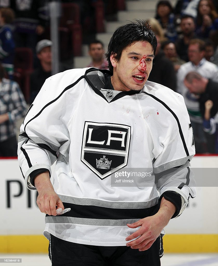 <a gi-track='captionPersonalityLinkClicked' href=/galleries/search?phrase=Jordan+Nolan&family=editorial&specificpeople=4161890 ng-click='$event.stopPropagation()'>Jordan Nolan</a> #71 of the Los Angeles Kings heads for repairs after fighting Tom Sestito of the Vancouver Canucks during their NHL game at Rogers Arena March 2, 2013 in Vancouver, British Columbia, Canada.