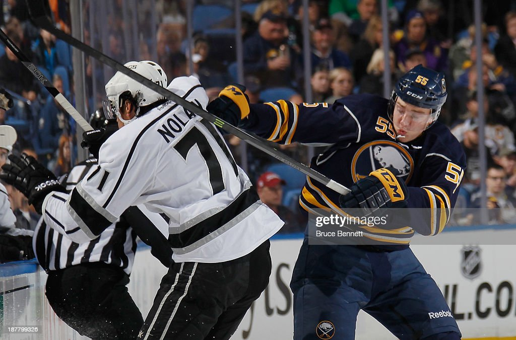 Jordan Nolan #71 of the Los Angeles Kings is hit by Rasmus Ristolainen #55 of the Buffalo Sabres during the second period at the First Niagara Center on November 12, 2013 in Buffalo, New York.