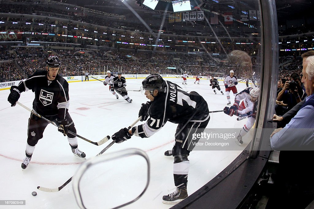 <a gi-track='captionPersonalityLinkClicked' href=/galleries/search?phrase=Jordan+Nolan&family=editorial&specificpeople=4161890 ng-click='$event.stopPropagation()'>Jordan Nolan</a> #71 of the Los Angeles Kings makes a pass from the corner boards while under pressure from <a gi-track='captionPersonalityLinkClicked' href=/galleries/search?phrase=Nick+Foligno&family=editorial&specificpeople=537821 ng-click='$event.stopPropagation()'>Nick Foligno</a> #71 of the Columbus Blue Jackets during the NHL game at Staples Center on April 18, 2013 in Los Angeles, California. The Kings defeated the Blue Jackets 2-1.