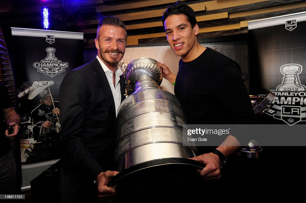 <a gi-track='captionPersonalityLinkClicked' href=/galleries/search?phrase=Jordan+Nolan&family=editorial&specificpeople=4161890 ng-click='$event.stopPropagation()'>Jordan Nolan</a> #71 of the Los Angeles Kings poses for a picture with <a gi-track='captionPersonalityLinkClicked' href=/galleries/search?phrase=David+Beckham&family=editorial&specificpeople=158480 ng-click='$event.stopPropagation()'>David Beckham</a> during a team championship party at the LA LIVE Ritz-Carlton on June 13, 2012 in Los Angels, California.