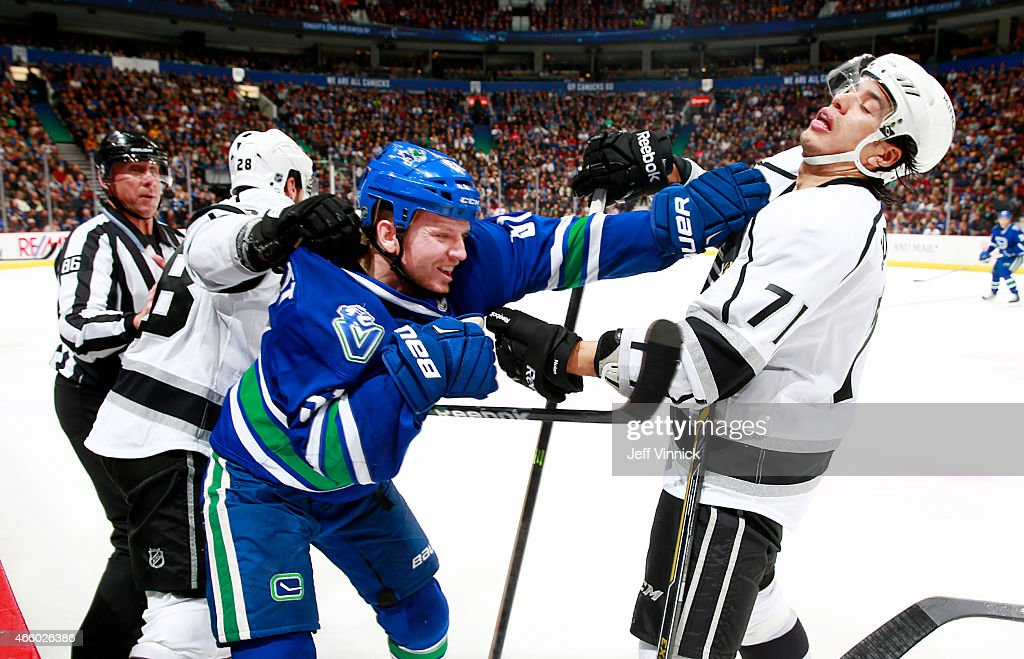 <a gi-track='captionPersonalityLinkClicked' href=/galleries/search?phrase=Jordan+Nolan&family=editorial&specificpeople=4161890 ng-click='$event.stopPropagation()'>Jordan Nolan</a> #71 of the Los Angeles Kings reacts to a shove by <a gi-track='captionPersonalityLinkClicked' href=/galleries/search?phrase=Derek+Dorsett&family=editorial&specificpeople=4306277 ng-click='$event.stopPropagation()'>Derek Dorsett</a> #51 of the Vancouver Canucks during their NHL game at Rogers Arena March 12, 2015 in Vancouver, British Columbia, Canada.
