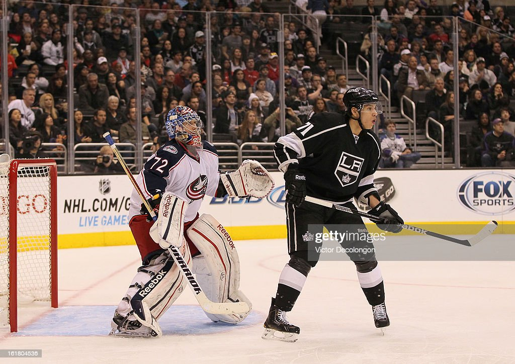 Jordan Nolan #71 of the Los Angeles Kings sets a screen in front of goaltender Sergei Bobrovsy #72 of the Columbus Blue Jackets during the NHL game at Staples Center on February 15, 2013 in Los Angeles, California. The Kings defeated the Blue Jackets 2-1.