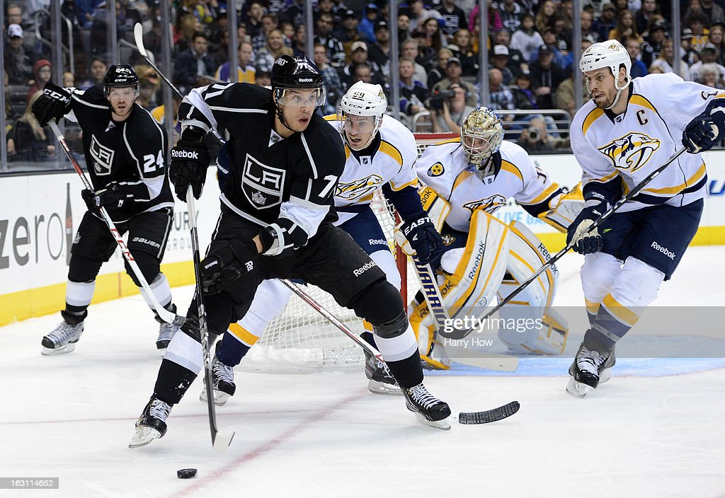 Jordan Nolan #71 of the Los Angeles Kings skates in front of Roman Josi #59, Pekka Rinne #35 and Shea Weber #6 of the Nashville Predators during the second period at Staples Center on March 4, 2013 in Los Angeles, California.