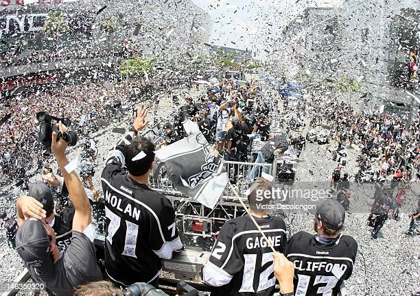 Jordan Nolan of the Los Angeles Kings waves to fans in the midst of confetti falling down during the Los Angeles Kings Stanley Cup Victory Parade on...